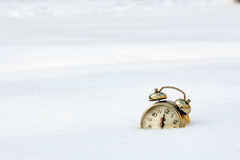 A old clock in the pure white snow Stock Photo