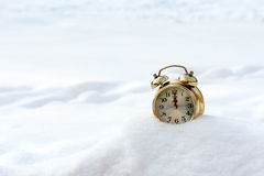 a old clock in the pure white snow Stock Photos