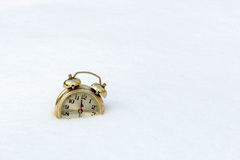 a old clock in the pure white snow Stock Images