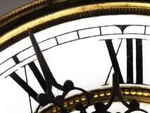 Old clock with roman numerals. Stock Photo