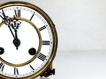 Old clock with roman numerals. Royalty Free Stock Images