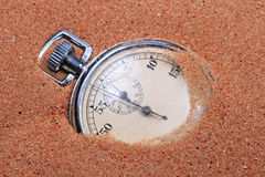 An old clock in the sand. An old clock in the sand of a beach Stock Photography