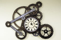 Old clock with sprockets Stock Image