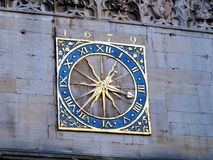 Old clock at St Mary's Church Cambridge. An old clock on the wall of an old church in Cambridge Royalty Free Stock Photo