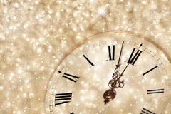 Old clock with stars snowflakes and holiday lights Stock Photos