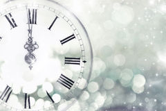 Old clock with stars and snowflakes. New Year's at midnight - Old clock with stars snowflakes and holiday lights Stock Photos
