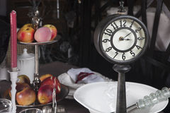 Old clock at the table Stock Image