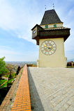 Old clock tower in the city of Graz, Austria Royalty Free Stock Photos