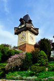Old clock tower in the city of Graz, Austria Stock Images