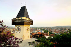 Old clock tower in the city of Graz, Austria Royalty Free Stock Photography