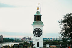 Old clock tower with inverted minutes and hours pointers on Petrovaradin fortress in Novi Sad City.  Stock Photography