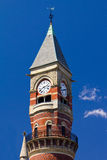 Old Clock Tower Isolated on Blue Sky Stock Images