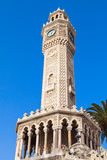 Old clock tower under blue sky, Izmir, Turkey Stock Images