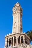 Old clock tower under blue sky, Izmir, Turkey Stock Images
