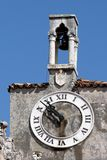 Old clock tower and the Venetian bells Royalty Free Stock Images