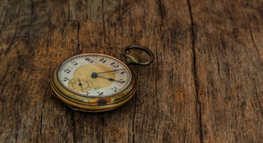 Old  clock  vintage  picture in wood background Royalty Free Stock Photos
