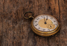 Old  clock  vintage  picture in wood background Stock Photography