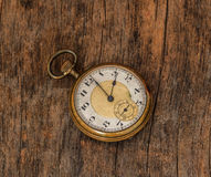 Old  clock  vintage  picture in wood background Royalty Free Stock Image
