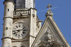Old clock on the wall of a church of Saint Etienne. Du Mont, Paris, France and a jet in the background Stock Photography