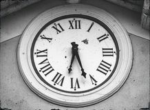 Old clock on the wall Black and white. Old clock on the wall monochromatic royalty free stock image