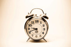 Old clock on yellow background. Stock Photography