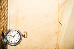 Old clock on yellow paper Royalty Free Stock Images