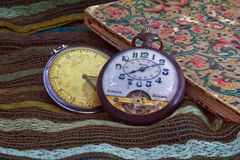 Old clocks and address book over a cotton cloth. Royalty Free Stock Image