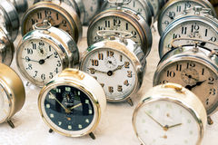 Old clocks at the flea market. Old alarm clocks at the flea market stock photos