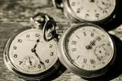 Old clocks. Vintage picture in wood background royalty free stock photography