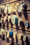 Old clocks on the wooden wall. Closeup of old clocks on the wooden wall royalty free stock photo