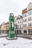 Old clocktower with advertising for washing powder in snow. MUEHLHAUSEN, GERMANY - JAN 17, 2016: old clocktower with advertising for washing powder in snow in Stock Images