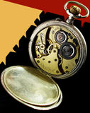 Old clockwork. With color background. The back cover pocket watch otkrata. The mechanism is visible. On the cover of hours fingerprints Royalty Free Stock Photos
