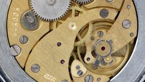 Old clockwork. Clockwork inside of old watch stock footage