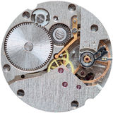 Old clockwork it is isolated on a white background. Old clockwork close up isolated on a white background Stock Photo