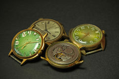Old clockwork and old mechanical watches Stock Photos