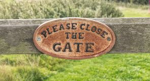 Old close the gate sign, Yorkshire royalty free stock photo
