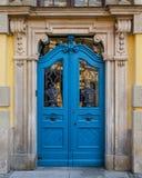 Old closed blue door Stock Photo