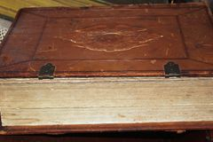 Old leather bound book lying on its side royalty free stock photography