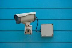 Old Closed Circuit Television Camera or Security CCTV camera setting on blue wooden background. Selective focus royalty free stock photos