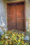Old closed door in abandoned house. Old door in abandoned house covered with spyder web Stock Photo