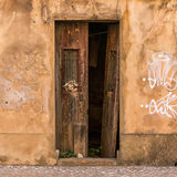 Old closed door. An old, broken and closed door in Portugal Royalty Free Stock Images