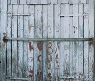 Old closed doors with peeling paint Royalty Free Stock Image