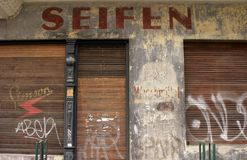 Old closed soap shop. Vintage soap shop with graffiti Stock Photo