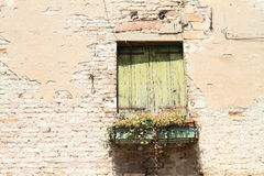 Old closed window in broken wall Royalty Free Stock Image