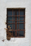 Old closed window with iron bars Stock Photos
