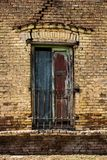 Old closed window with plates. royalty free stock photography