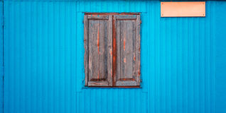 Old closed window. Old shuttered window in the new wall paneling Royalty Free Stock Image