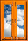Old closed wood glass window frame with clouds stock photo