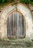 Old closed wooden door with concrete arc Stock Image