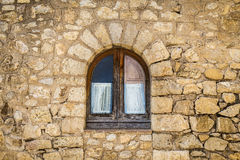 Old closed wooden window on a stone wall Royalty Free Stock Photography
